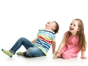 Joint birthday parties. Young boy and girl laughing