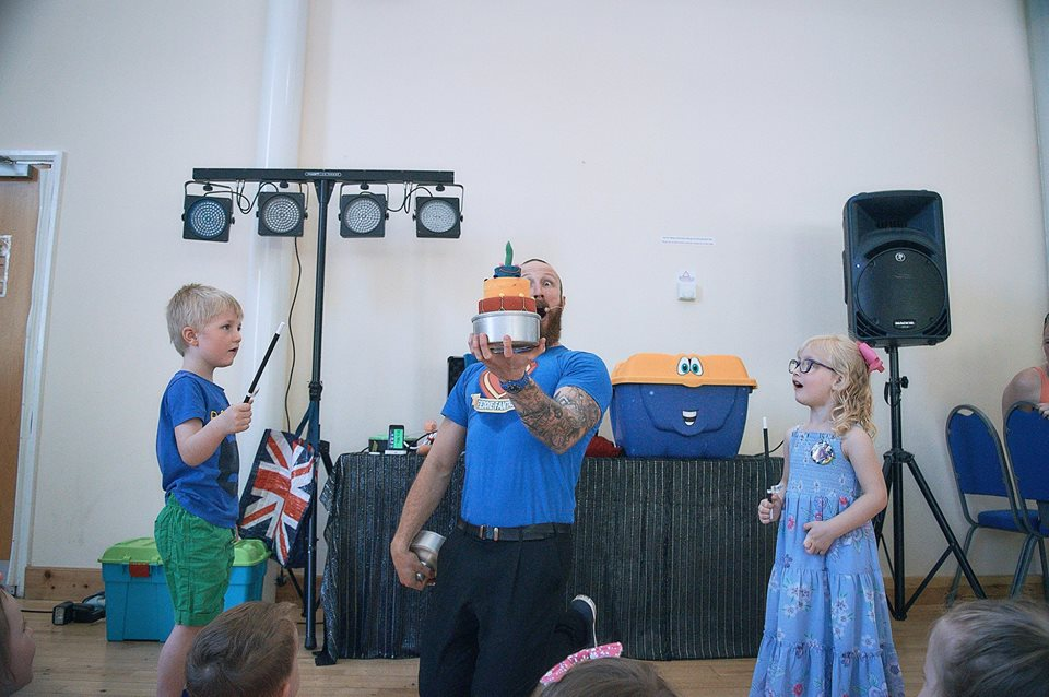 Freddie Fantastic entertains at a joint birthday party for children